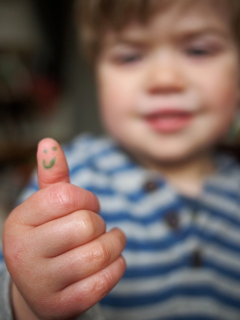 Xavier's teacher has won him over by drawing a smiley face on his finger at the end of each day  (often requiring washing hands without getting his thumb wet)